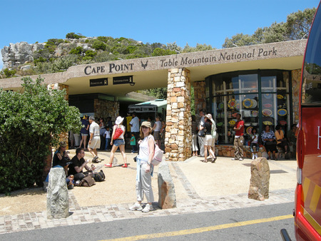 cape of good hope: CAPE POINT, SOUTH AFRICA - DECEMBER 30, 2007: Tourists near entrance of Cape Point, South Africa. Cape Point is situated within the Table Mountain National Park, within a section of the park referred to as Cape of Good Hope. Editorial