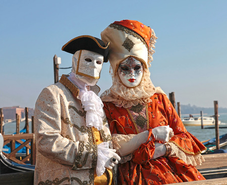piazza san marco: VENICE, ITALY - FEBRUARY 8, 2015: Costumed people in Venetian mask on the Piazza San Marco during Venice Carnival in Venice, Italy. Selective focus Editorial