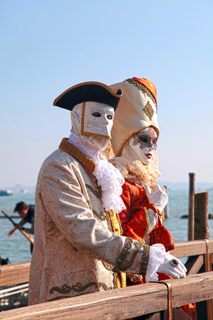 medieval: VENICE, ITALY - FEBRUARY 8, 2015: Unidentified persons in Venetian mask and romantic costumes at St. Marco Square, Carnival of Venice, Italy. Selective focus