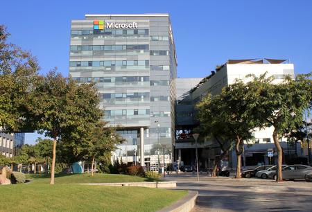 microsoft: HERZLIYA, ISRAEL - AUGUST, 31, 2015: Urban landscape with modern futuristic architecture building Microsoft office, Herzliya, Israel.
