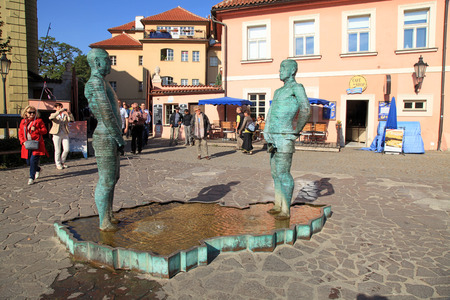 nude young: PRAGUE, CZECH REPUBLIC - OCTOBER 3, 2015: Tourists and Fountain Pissing Men near Kafka Museum in Prague,Czech Republic. Fountain by David Cerny, sculptor whose works can be seen in many locations in Prague. Редакционное