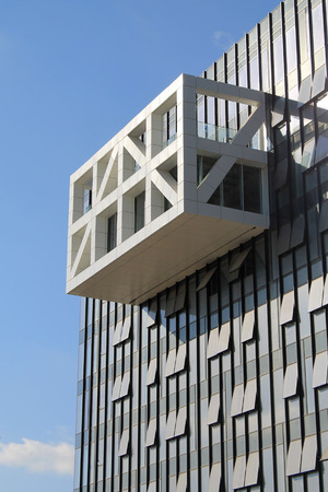 investment real state: Architectural detail of a modern building on blue sky background