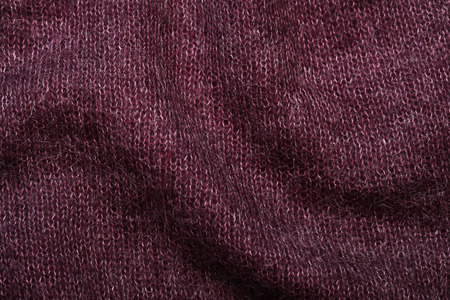 moher: purple soft knitting wool moher texture background, selective focus