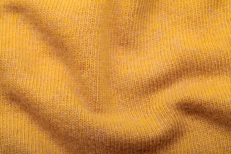 moher: yellow soft knitting wool moher texture background, selective focus