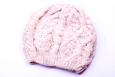 spliced: wool knitted hat on white background