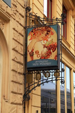 advertising signs: PRAGUE, CZECH REPUBLIC - OCTOBER 4, 2015: Signboard of restaurant Sarah Bernhardt in Old Town Prague, Czech Republic.