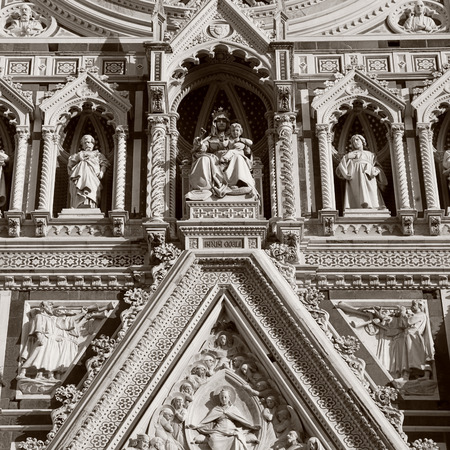 fiore: Detail from main facade of Cathedral of Santa Maria del Fiore in Florence,Italy. Square toned monochrome image