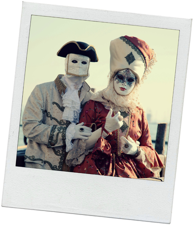 piazza san marco: VENICE, ITALY - FEBRUARY 8, 2015: Costumed couple in Venetian mask on the Piazza San Marco during Venice Carnival in Venice, Italy. Vintage toned polaroid image on white background. Stock Photo