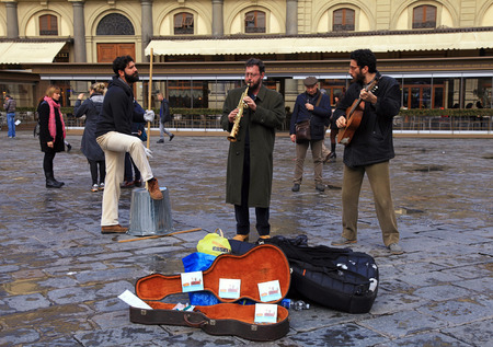jazz time: FLORENCE, ITALY - JANUARY 10, 2016: Three street musicians band perform in the street at Florence, Italy.