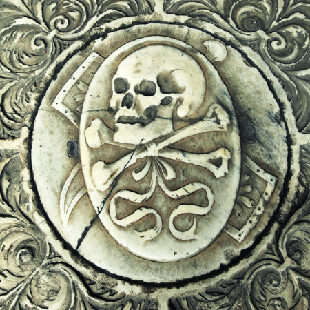 campo dei miracoli: Skull on the medieval marble tomb in Monumental cemetery Camposanto, Pisa, Italy. square toned image, instagram effect Stock Photo
