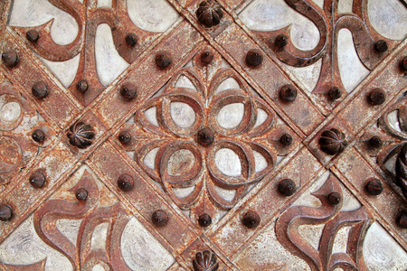 Rusty details and ornaments of wrought iron medieval door