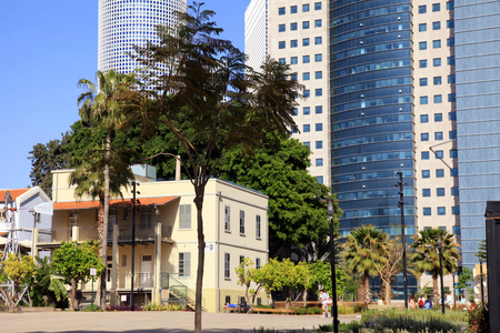 azrieli: TEL AVIV, ISRAEL - APRIL 7, 2016 : Modern open air commercial center Sarona over skyscrapers of Azrieli Center in Tel Aviv, Israel. Recently open Sarona Market became the most popular place in Tel Aviv.