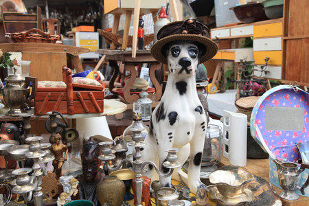 Old vintage objects and furniture for sale at a flea market. Toy vintage dog. Selective focus Archivio Fotografico