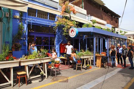 yaffo: TEL AVIV-YAFO, ISRAEL - APRIL 5, 2016: People at outdoor cafe at popular Jaffa flea market district, Tel Aviv, Israel. Editorial