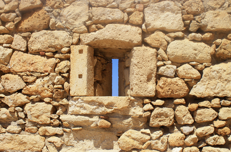 greece granite: Window in old stone wall ruins of a medieval fortress on Crete Island, Greece Stock Photo