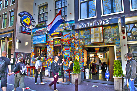 coffeeshop: AMSTERDAM, NETHERLANDS - MAY 5, 2016: Cityscape with people and the Bulldog coffeeshop in Amsterdam, Netherlands. HDR image, selective focus Editorial