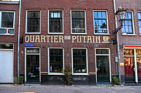 day light: AMSTERDAM, NETHERLANDS - MAY 5, 2016: Quartier Putain cafe in Amsterdams red lights district near Oude Kerk(Old Church) in Amsterdam, Netherlands.