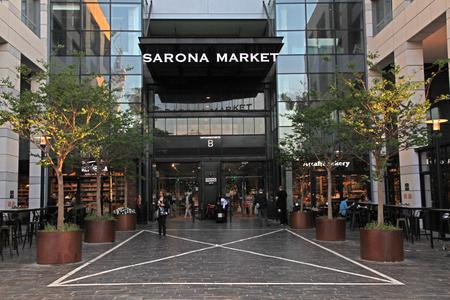 garden settlement: TEL AVIV, ISRAEL - APRIL 7, 2016 : People in Sarona Food Market in Tel Aviv, Israel. Recently open Sarona Market became the most popular place in Tel Aviv.