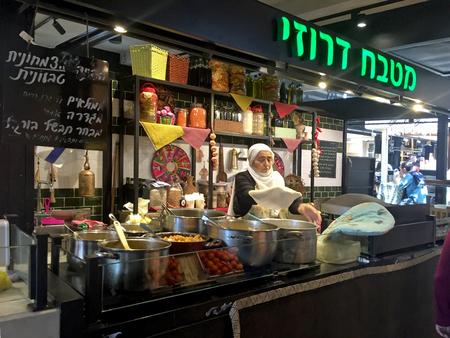 arabian food: TEL AVIV, ISRAEL - APRIL 7, 2016: Arabian street food cafe in the new Sarona Market, Tel Aviv, Israel.