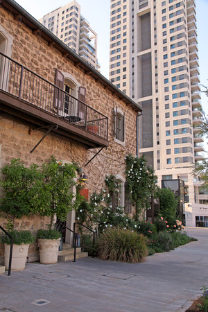 garden settlement: Old and modern buildings at dusk at the Sarona district, Tel Aviv, Israel. Recently open Sarona Market became the most popular place in Tel Aviv. Editorial