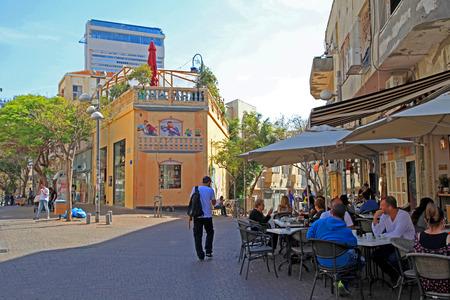 TEL AVIV, ISRAEL - APRIL 3, 2016: People at outdoor cafe at Nahalat Binyamin district, Tel Aviv, Israel. Selective focus. Sajtókép