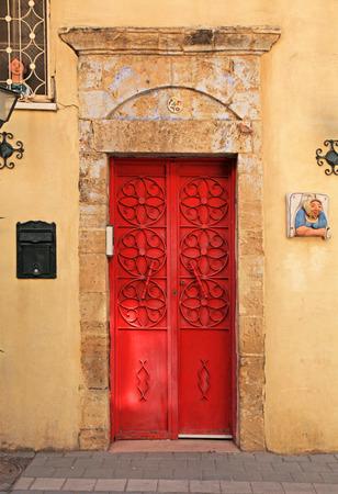 tel: Red antique door in Tel Aviv, Israel Stock Photo