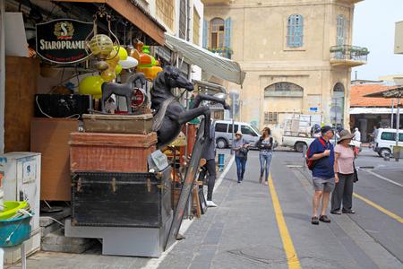 fleamarket: TEL AVIV-JAFFA, ISRAEL - APRIL 5, 2016:People on The Flea Market, Shuk Hapishpeshim in old district Jaffa, Tel Aviv, Israel. Editorial