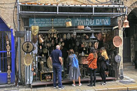fleamarket: TEL AVIV-JAFFA, ISRAEL - APRIL 5, 2016: Visitors on The Flea Market, Shuk Hapishpeshim in old district Jaffa, Tel Aviv, Israel.