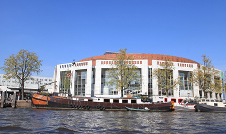 AMSTERDAM, NETHERLANDS - MAY 6, 2016: Dutch National Opera & Ballet, Nationale opera and ballet building (Stopera) in Amsterdam, Netherlands. The Stopera is located in the center of Amsterdam.