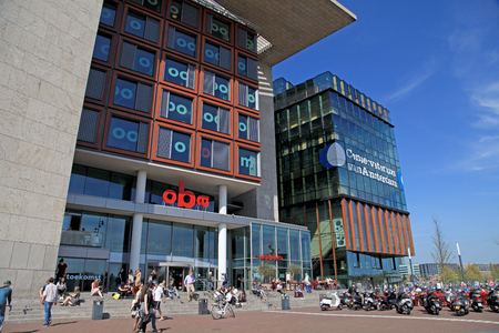centres: AMSTERDAM, THE NETHERLANDS - MAY 6, 2016: Modern buildings of Conservatory and Library,cultural centres,example of modern architecture and design of Amsterdam. Editorial