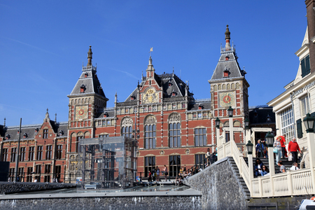 AMSTERDAM, NETHERLANDS - MAY 6, 2016:Amsterdam Central Train Station in Amsterdam, Netherlands .Every day 250,000 go through Amsterdams Central Station.