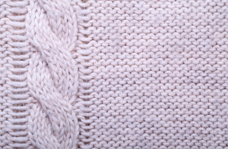 cable stitch: close up knitted wool texture can use as background