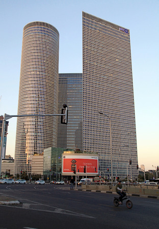 TEL AVIV, ISRAEL - APRIL 7, 2016 : View of Azrieli Center in Tel Aviv, Israel. Azrieli center is the complex of 3 skyscrapers and the largest shopping mall in Israel. Sunset light.