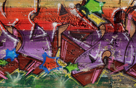 Beautiful abstract street art graffiti on concrete urban walls.
