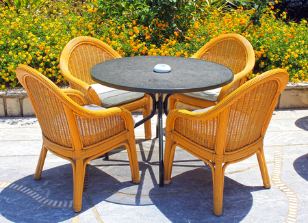 patio chairs: Wicker patio chairs and table in the garden
