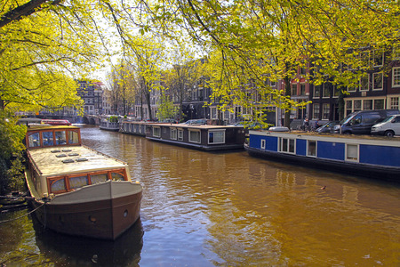 Beautiful Amsterdam scene with traditional dutch old buildings and houseboats in the canal, Jordaan neighborhood, Amsterdam, the Netherlands