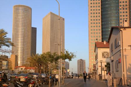 azrieli: TEL AVIV, ISRAEL - APRIL 7, 2016 : Cityscape with towers of Azrieli Center and Sarona area in Tel Aviv, Israel. Azrieli center is the main landmark of Tel Aviv. Sunset light. Editorial