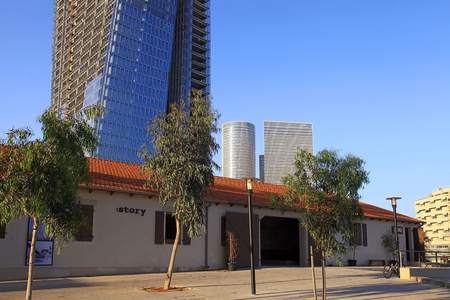 azrieli: TEL AVIV, ISRAEL - APRIL 7, 2016: View of open air commercial center Sarona and skyscrapers, Tel Aviv, Israel. Open Sarona Market became most popular place in Tel Aviv.