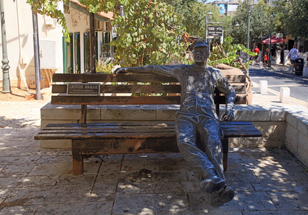 jewish town: ZIKHRON YAAKOV, ISRAEL - AUGUST 20, 2016: Worker sculpture on bench in Zichron Yaakov, Israel. It was one of first Jewish settlements in Israel founded in 1882 by Baron Edmond James de Rothschild. The town draws many tourists to its picturesque setting an Editorial