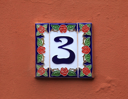number 3: Home ceramic tile with number 3 mounted on stone facade, Italy