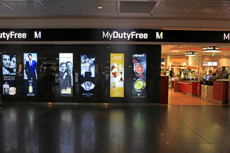 retail therapy: MUNICH, GERMANY - JULY 25, 2016: Duty free shop in Munich International Airport, Germany. The Munich Airport (MUC), Germanys second busiest airport, is a major hub for Lufthansa (LH)