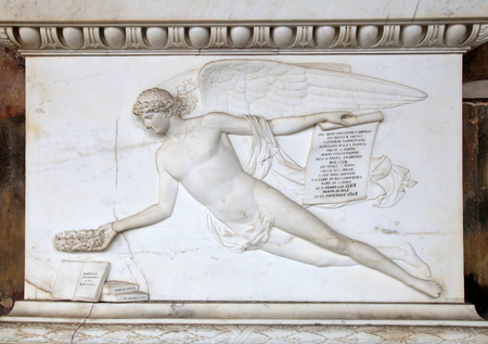 angel cemetery: Angel relief on marble tomb in a medieval cemetery, Pisa, Italy