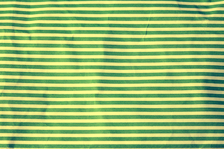 green line: vintage crumpled paper with white and green stripes, toned image