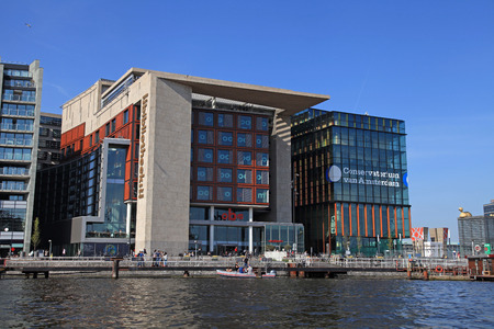 AMSTERDAM, THE NETHERLANDS - MAY 6, 2016: Modern buildings of Conservatory and Library,cultural centres,example of modern architecture and design of Amsterdam. Editorial