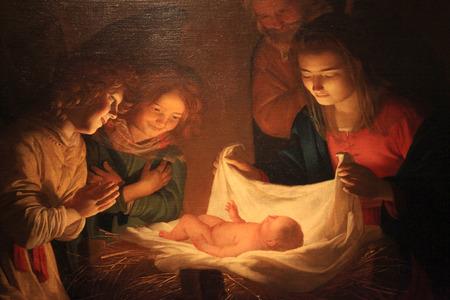 """FLORENCE, WŁOCHY - 10 stycznia 2016: """"Adoracja dziecka"""" Gerard van Honthorst (Gherardo delle Notti) Malarstwo Bożego Narodzenia, Galeria Uffizi, Florencja, Włochy."""