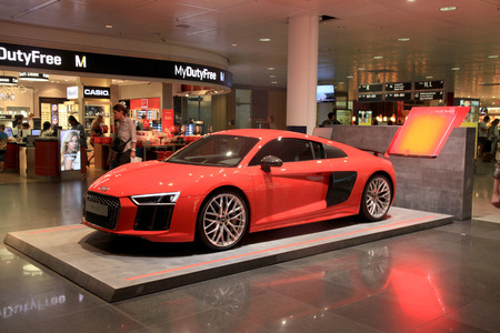 MUNICH, GERMANY - JULY 25, 2016: AUDI stand in Duty free area in Munich International Airport, Germany. The Munich Airport (MUC), Germanys second busiest airport, is a major hub for Lufthansa (LH)