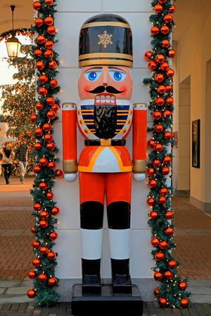 nutcracker: Soldier nutcracker statue and Christmas tree decoration on the street