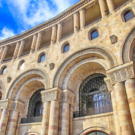 ministry: Facade of historic building with architectural details, arches and columns in center of Yerevan, Armenia. Square image