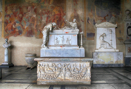 camposanto: PISA, ITALY - JANUARY 9, 2016: Tomb sculptures on marble tomb in a medieval Memorial Camposanto Cemetery, Pisa, Italy