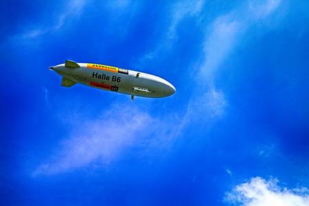 air bladder: STEIN AM RHEIN, SWITZERLAND - MAY 5, 2013: The blimp Zeppelin fly over Stein am Rhein, Switzerland Editorial